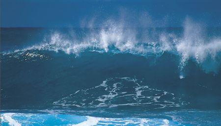 a big wave crashing towards the shore Stock Photo