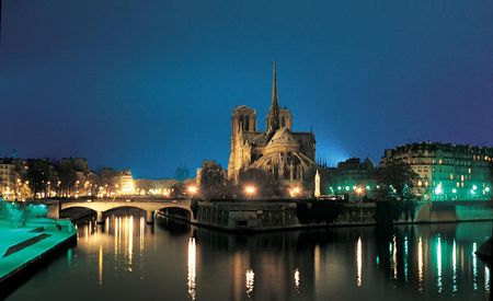 Notre Dame Cathedral (Paris) - By night from the river Stock Photo