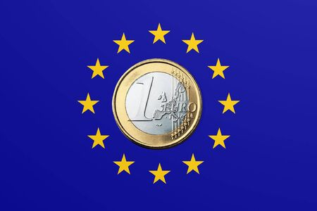 European Union Flag and one euro coin Stock Photo