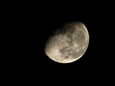 Large half moon on black night sky
