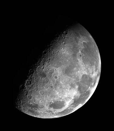 Large half moon on black night sky - close up Stock Photo
