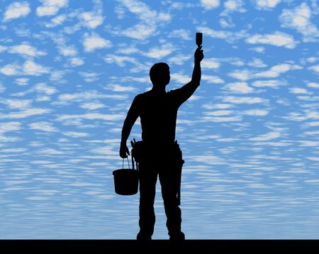 MAN AT WORK - SILHOUETTE - Dark image outlined against a fluffy clouds background photo