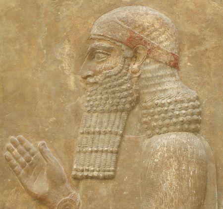 Ancient face - Ancient Assyrian Sculpture -  face close up  Stock Photo