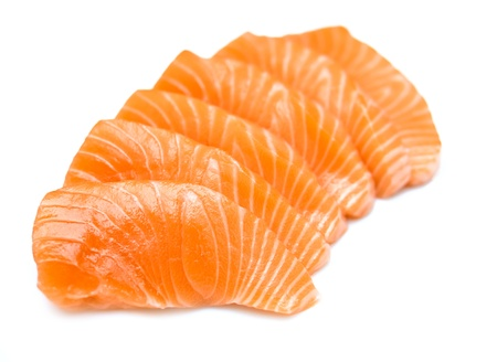 Isolated sliced raw salmon (salmon sashimi)