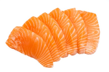Isolated sliced raw salmon (salmon sashimi)