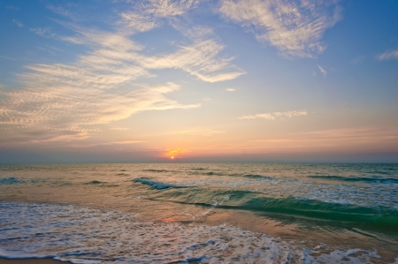 sunrise at the beach: Beach in Cha-am, Thailand. Shooted in the morning with amazing sunrise sky. Stock Photo