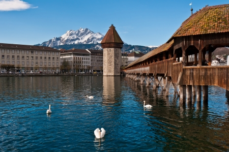 Wooden Chapel Bridge of Lucerne in Switzerland with tower Stock Photo - 14693994