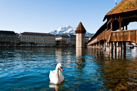 Wooden Chapel Bridge of Lucerne in Switzerland with tower photo