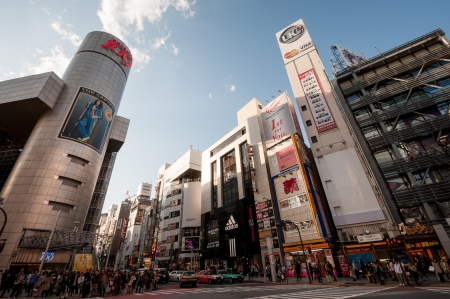 Tokyo, Japan - April 4, 2012 : Shibuya 109 building with crowd waiting to cross the street in Shibuya, the most popular place to meeting and shopping.
