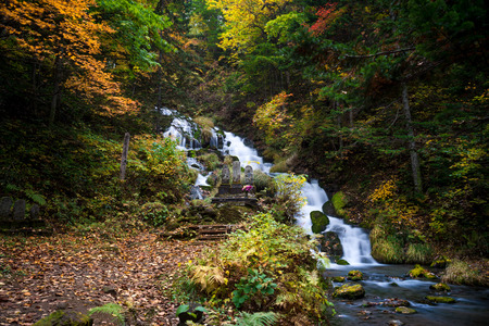 Shirogane Fudo waterfall in Biei, Hokkaido, with autumn scene photo