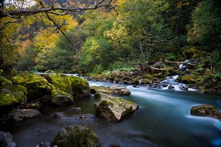 Ishikari river and waterfall in Sounkyo,Hokkaido, with autumn scene