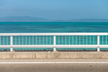Tropical ocean with fence and road 写真素材
