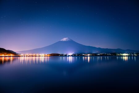 Mount Fuji and lake Kawaguchi (Kawaguchiko) at night, Yamanashi, Japan