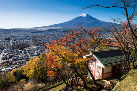 Autumn scene of Mount Fuji and Fujiyoshida city from Arakurayama sengen park, Yamanashi, Japan.
