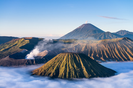 mount: Mount Bromo volcano during sunrise with Batok and Semeru mountain, located in Bromo Tengger Semeru National Park, East Java, Indonesia. Stock Photo