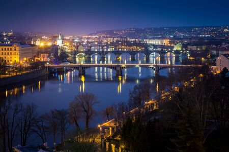 Night cityscape of Charles bridge and Vltava river from Letna park, Czech Republic