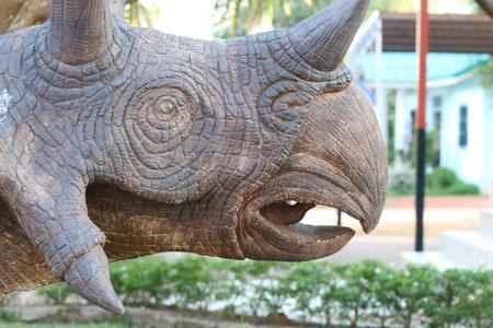 statuary garden: dinosaur statuary in park garden