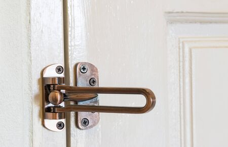 wooden insert: modern style door handle on wooden door.
