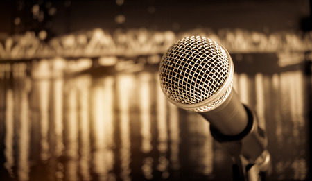 Microphone on abstract blurred of speech in seminar room or speaking conference hall light, Event concert bokeh background, vintage tone