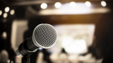 Microphone on abstract blurred of speech in seminar room or speaking conference hall light, Event concert bokeh background Reklamní fotografie
