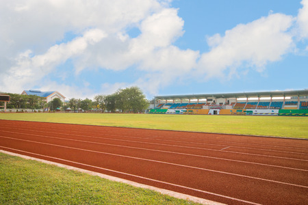 running track in stadium on blue sky for athletics and competition in university