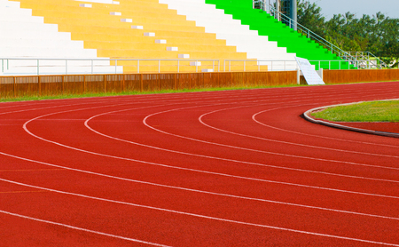 athletics stadium with red track : sport theme