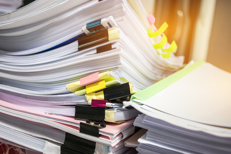 Paper stack, Pile of unfinished documents on office desk related to business functions. Stack of business papers for Annual Report files, Document is written,drawn,presented. Business offices concept.