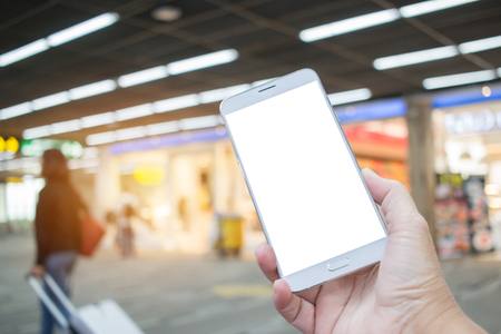 Business right hands using smartphone in class lounge waiting for plane flight. Mock up blank screen white template for advertising graphic display with blur airport terminal. insert text of customer