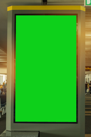 Blank billboard advertising panel in terminal airport, Mock up green screen, insert for text of customer. Space for texting in products or promotional at airport,train station,advertising public commercial. Stockfoto