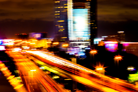 Colorful of city modern buildings night and road light abstract background, decorated with de-focus bokeh lights cities offices of reflecting building in Bangkok Thailand. Stockfoto