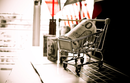 EURO money in trolley on laptop keyboard. Idea of exchange money online shopping, Online shopping is form of e-commerce, consumers to buy goods from directly seller through internet.