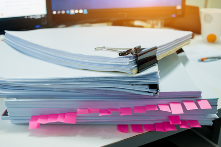 Stacks of documents files for finance of office working.Business report papers or Piles of unfinished document achieves with black clip paper. Concept of Business Annual Report. Stockfoto