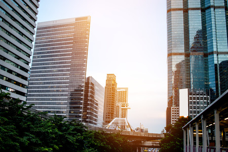 Bangkok view of business modern building in evening at bangkok mass transit system BTS, skytrain through city center Chong Nonsi Station.