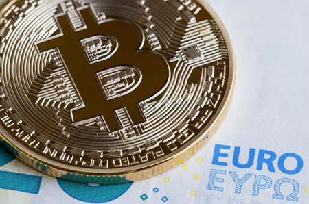 Bitcoin / Cryptocurrency is Digital payment money Concept, Gold coins with B letter symbol,electronic circuit on EURO EYP20 bill.Cryptocurrency can uses designed work as medium of exchange in network