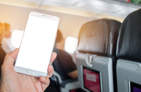 Business people hands holding use smart phone in airplane blurred background, mockup blank adverising template. insert for text of customer. Space for texting in your products or promotional. Stockfoto