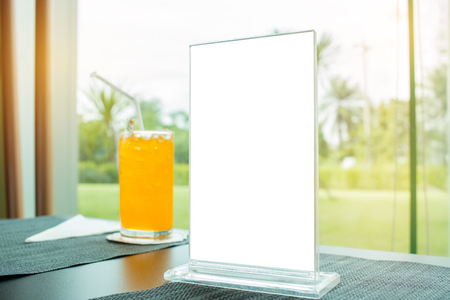 Mock up white Label for blank menu frame in Bar restaurant cafe. Stand for booklets with  sheets paper tent card on table cafeteria, blurred background insert for text of customer. Space for texting.
