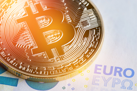 Bitcoin  Cryptocurrency is Digital payment money Concept, Gold coins with B letter symbol,electronic circuit on EURO EYP20 bill.Cryptocurrency can uses designed work as medium of exchange in network