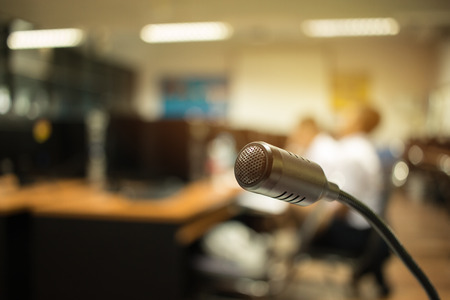 Blurred of Speaker mini mic, Microphone in Conference room or seminar meeting hall in business event or academic classroom training in lecture class, Concept of Speech and speaking.
