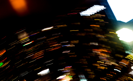 Beautiful lighting of Night futuristic line LED building abstract, Shooting style light color blur in Swirled night lights busy city abstract background. Movement of origin of multi colored lights. Stockfoto