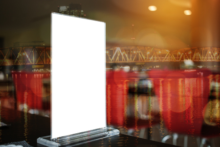 Mock up white Label on the table for blank menu frame in restaurant for booklets with sheets paper, Stand for acrylic tent card Used for Menu Bar, blur of light background insert for text of customer. Stockfoto