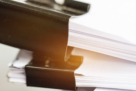 Stack of Paper documents with clip, Pile of unfinished documents on office desk folders. Business papers for Annual Report files, Document is written,presented. Business offices concept. Stok Fotoğraf - 99355549