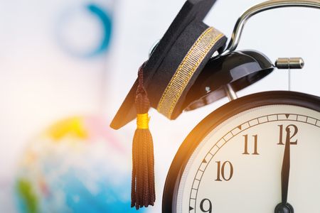 Time is Education, Graduation cap on top clock Concept of educational times Studies lead to success in life, Graduate study abroad program, Celebration Graduation Student Success Learning.