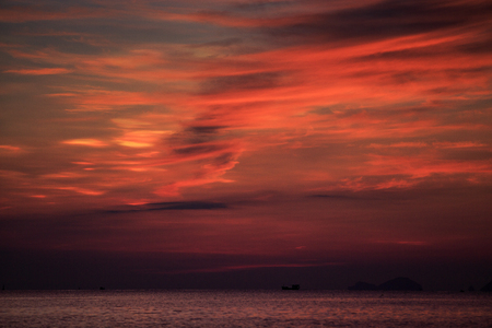 fleecy: panorama of fantastic beautiful red fleecy clouds before sunrise and sea on foreground