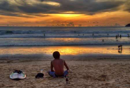 profesional: surfer relaxing after competition quiksilver 2010 september Phuket Editorial