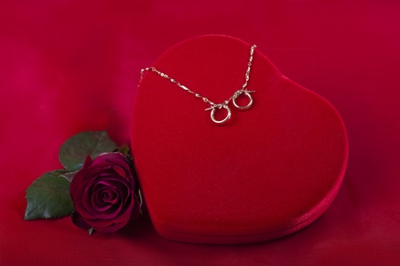 heart shaped box with jewelry and flower photo