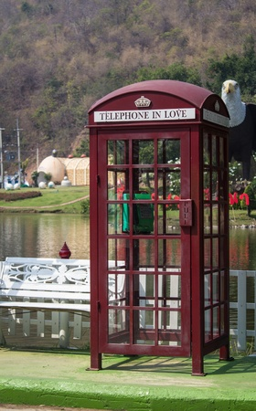 phonebox: A red telephone box in the color fresh  Stock Photo