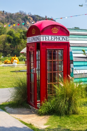 phonebooth: A red telephone box in the color fresh  Stock Photo