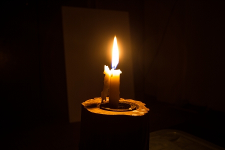 The lighting of candles, the dark art of light and darkness  photo