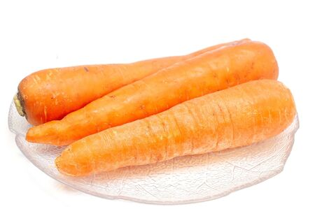Carrots on a plate isolated on white
