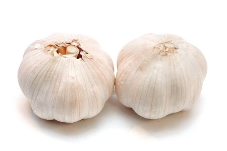 Whole garlic with slices isolated on white